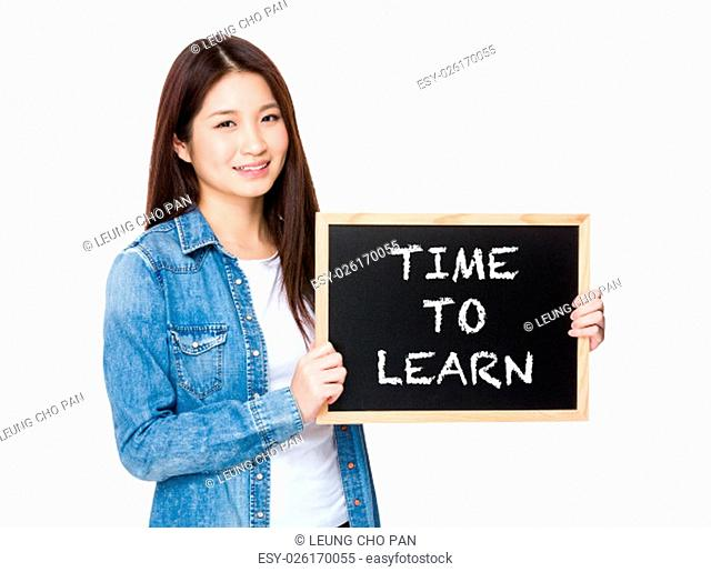 Woman with chalkboard showing phrase of time to learn