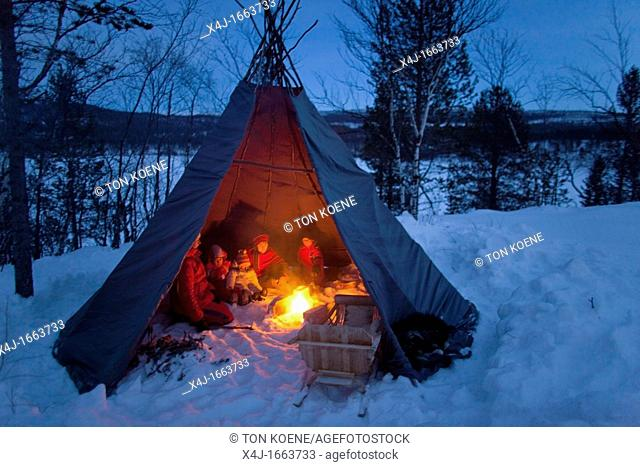 sami people camping in the north of Finland