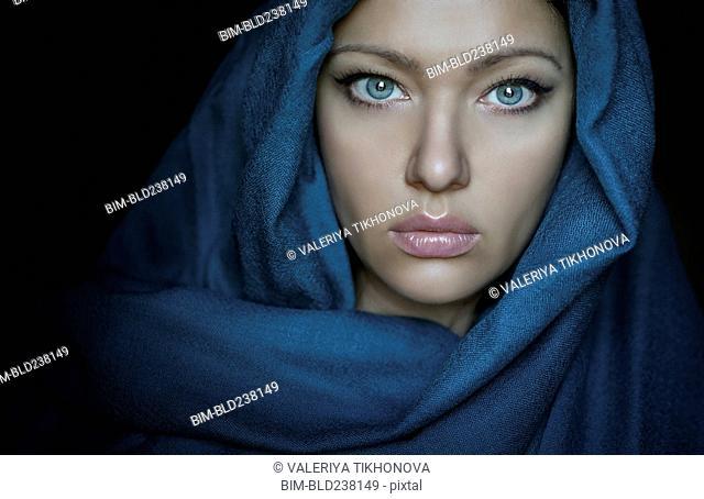 Caucasian woman wearing blue headscarf