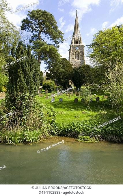 The church at West Adderbury in the Cotswolds, Oxfordshire, UK, looking across the river Glyme