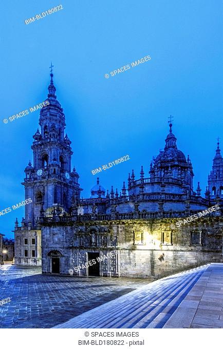 Ornate church illuminated at night, Santiago de Compostela, A Coruna, Spain