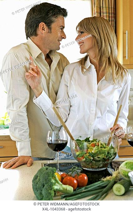 Young couple cooking at kitchen