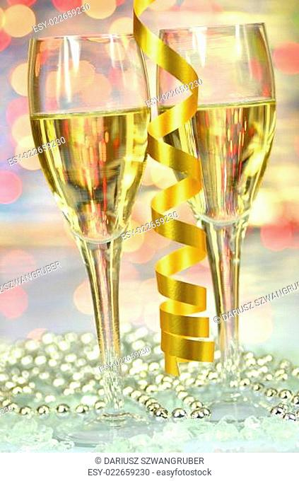 two glasses of champagne against bokeh background