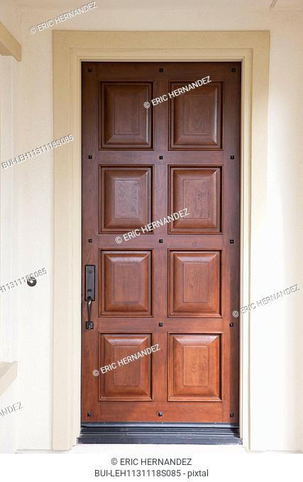 House entrance with closed brown door at Irvine; California; USA