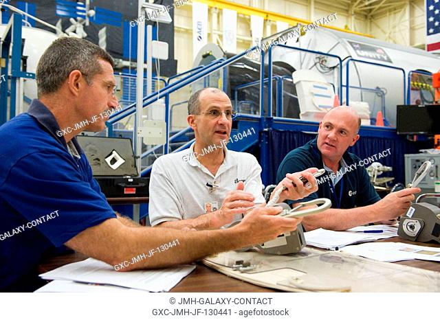 NASA astronaut Dan Burbank (left), Expedition 29 flight engineer and Expedition 30 commander; along with NASA astronaut Don Pettit (center) and European Space...