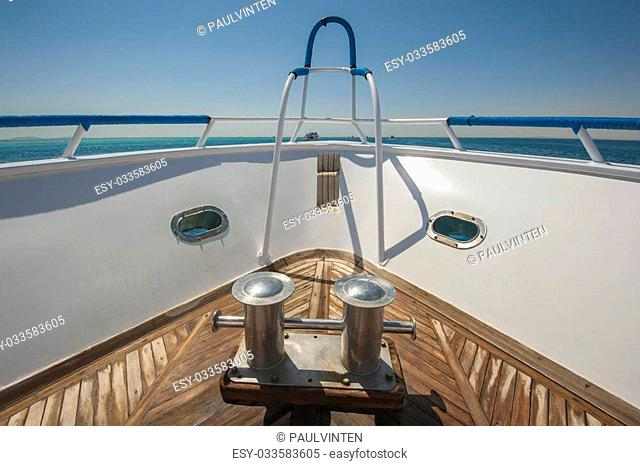 View from the bow of a luxury motor yacht on a tropical ocean