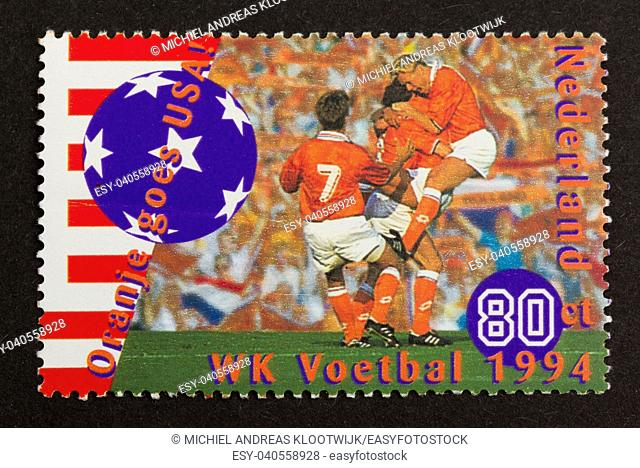 HOLLAND - CIRCA 1990: Stamp printed in the Netherlands shows a picture of the world championship football in the USA (1994), circa 1990
