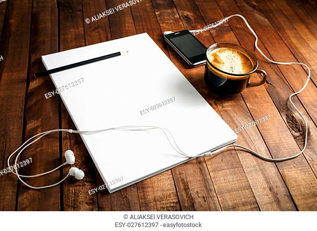 Blank paperwork template for designers. Responsive design mockup on vintage wooden background. Paper, letterhead, coffee cup, smartphone