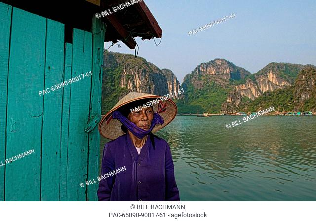South East Asia, Vietnam, Ha Long Bay, Portrait of a Vietnamese woman from behind, Harbor in background