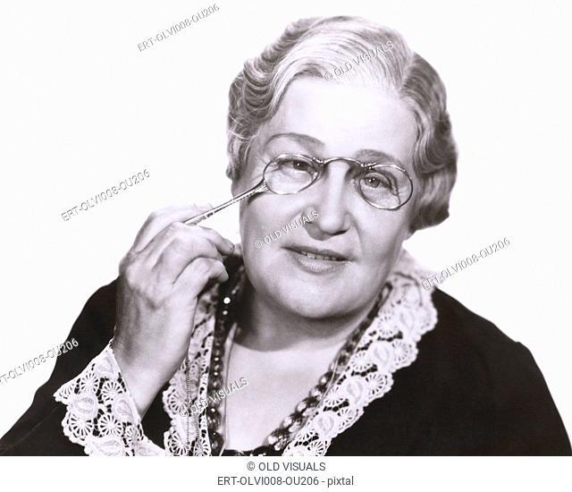 Woman holding lorgnette (OLVI008-OU206-F)