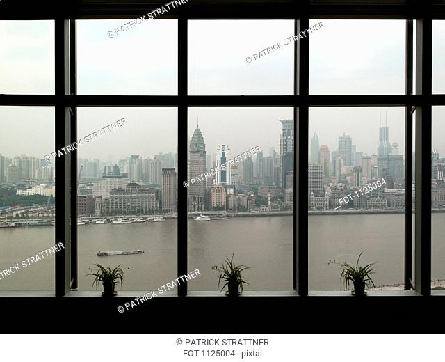 Shanghai skyline seen through window