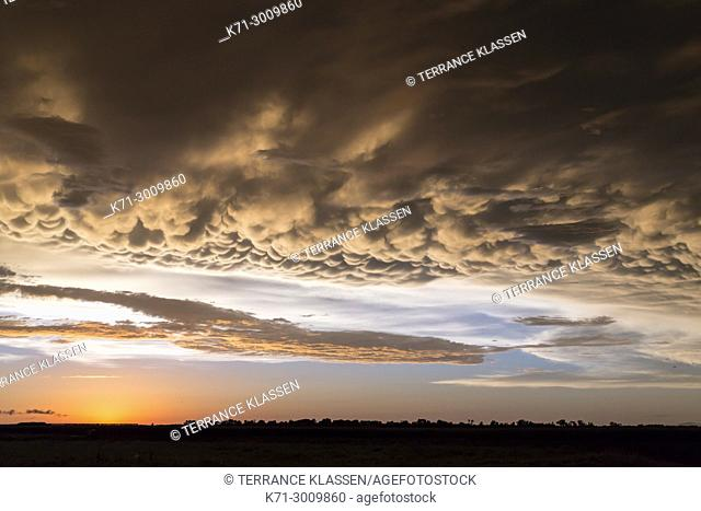 A clearing storm and clouds on the prairies at sunset near Winkler, Manitoba, Canada