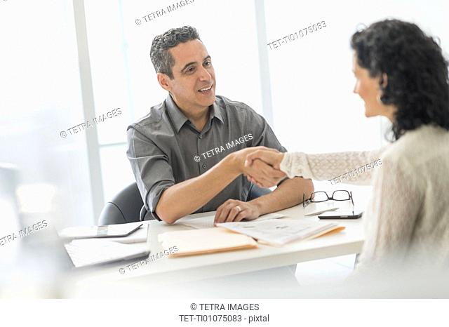 Business people talking at desk in office