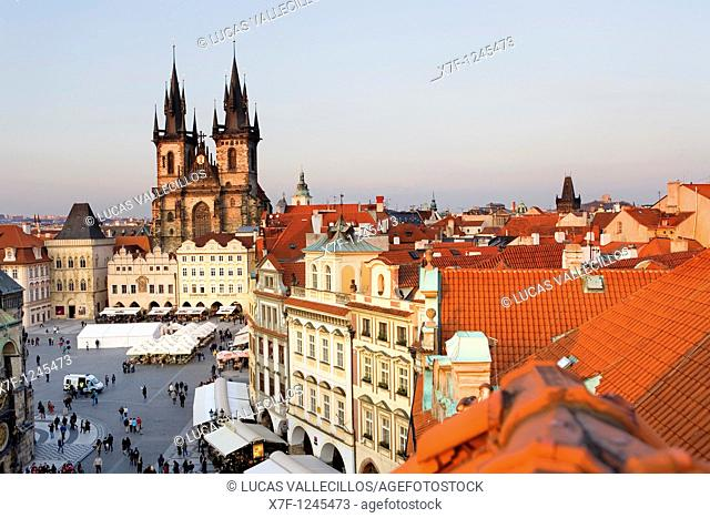 The Old town square with the Tyn church  At right housetops and Powder tower Prague  Czech Republic