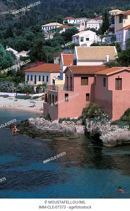 Assos, view of a pink house near the sea Kefallonia, Ionian Islands, Greece