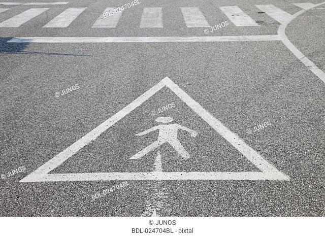 sign warning of zebra crossing on street