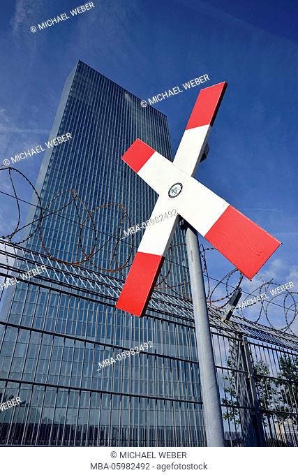 Road sign diagonal cross, barbed wire, fence, new building of the European Central Bank, ECB, Ostend, Frankfurt am Main, Hessia, Germany