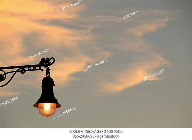 Streetlamp in the sunset. Maremagnum area, Port Vell, Barcelona, Catalonia, Spain