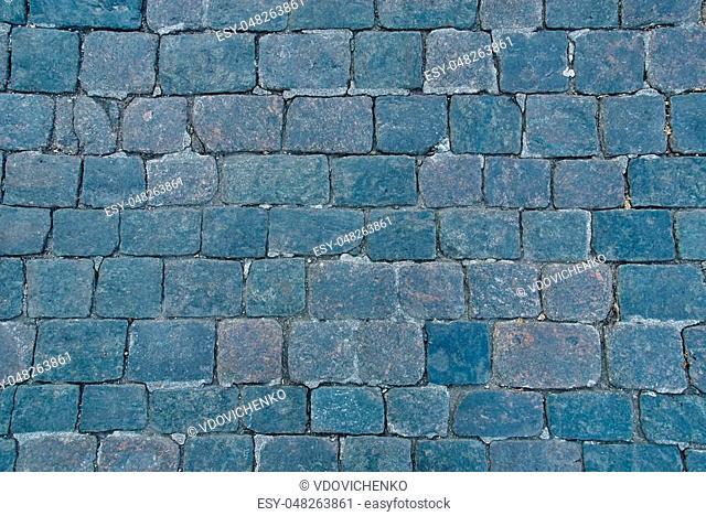 Background of sett. Cobblestone pavement. Texture