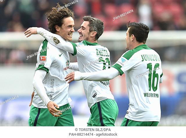 Bremen's Thomas Delaney celebrates with teammates Fin Bartels (C) and Zlatko Junuzovic (r) after giving his side a 2:0 lead in the German Bundesliga soccer...