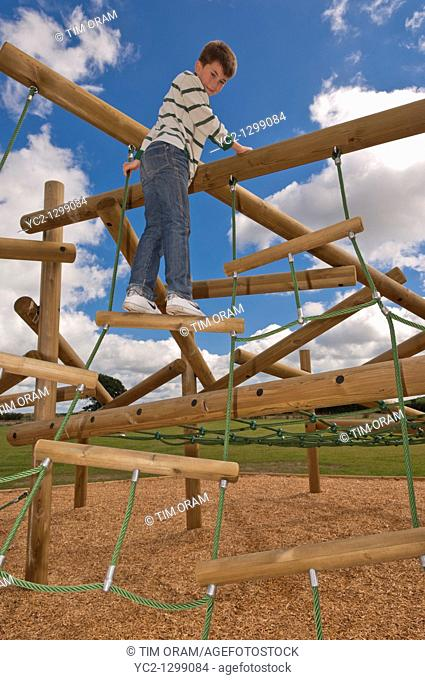 A  picture of an eleven year old boy on a climbing frame in the Uk