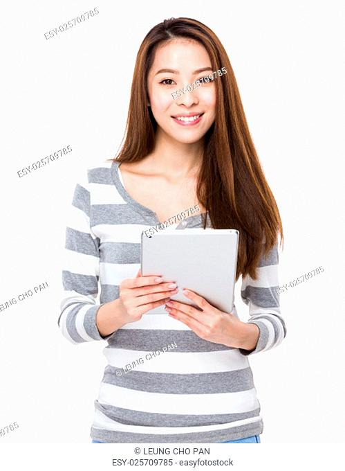 Young woman use of the digital tablet