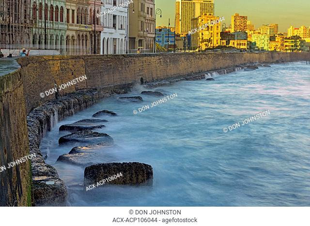 Street photogrphy in central Havana- Malecón (officially Avenida de Maceo) Seawall in the morning with surf