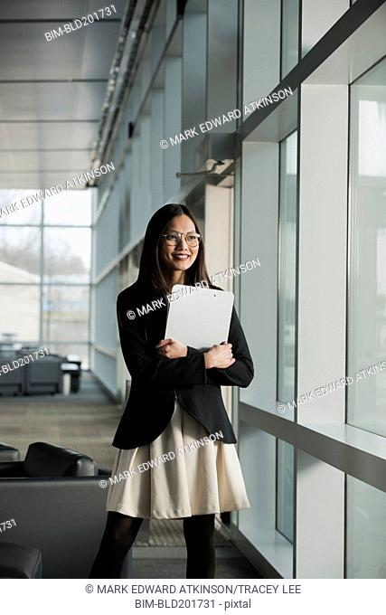 Asian businesswoman holding clipboard
