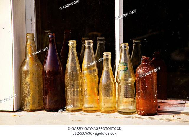 Row of old bottles Peggy's Cove; Nova Scotia; Canada
