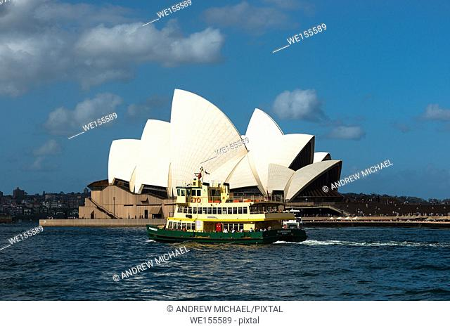 Ferry goes past the Sydney Opera House. Sydney, NSW, Australia