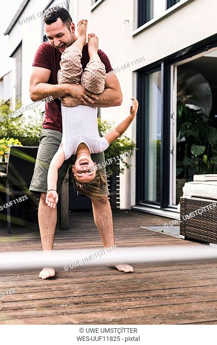 Father and daughter having fun in the garden