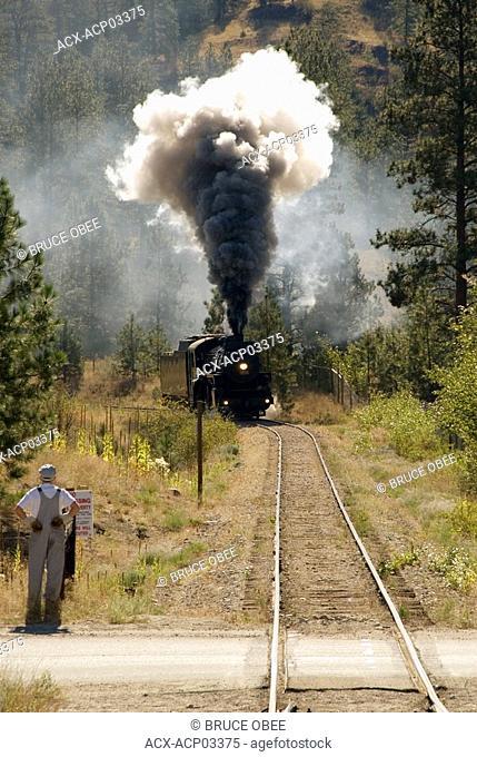 Kettle Valley Railway steam locomotive arrives at Prairie Valley station near summerland, thompson-okanagan, british columbia, canada