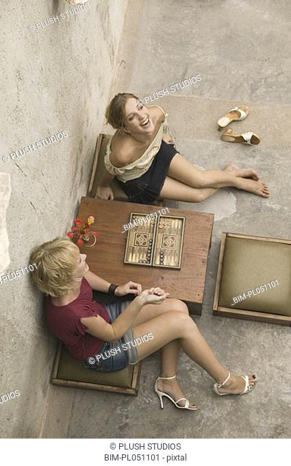 High angle view of two woman playing backgammon