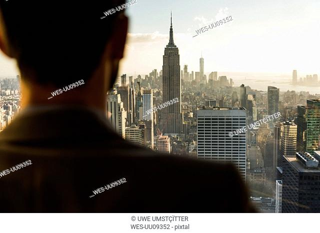 USA, New York City, man looking on cityscape on Rockefeller Center observation deck