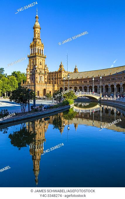Reflection in water at the Plaza de Espana or Spain Square in Maria Luisa Park in Seville, Andalusia, Spain