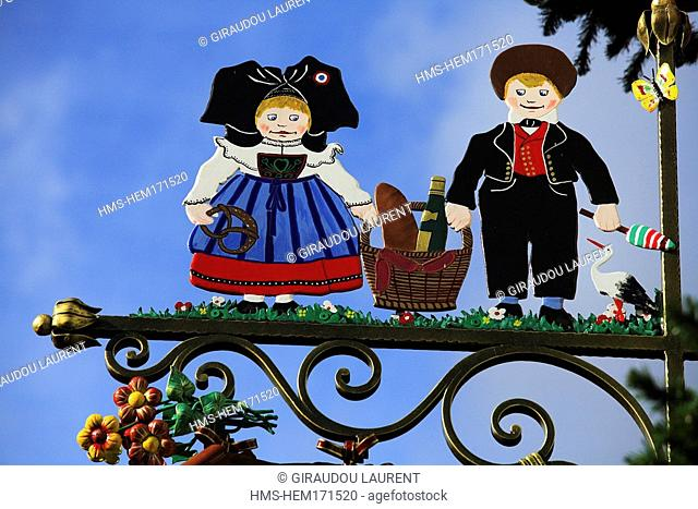 France, Haut Rhin, Alsace Wine Road, Eguisheim village, labelled The Most Beautiful Villages of France, sign with characters in typical outfit from Alsace