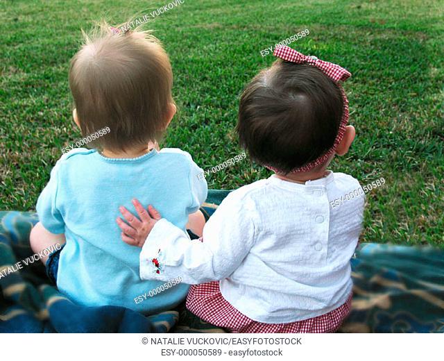 Two little friends in the back yard
