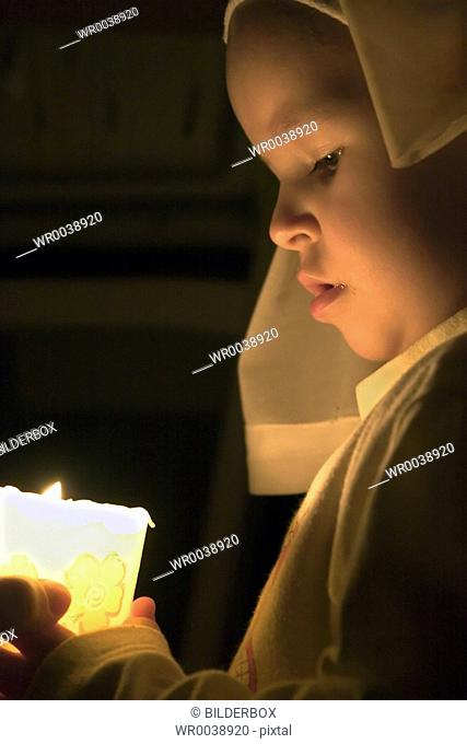 girl with a lighted candle