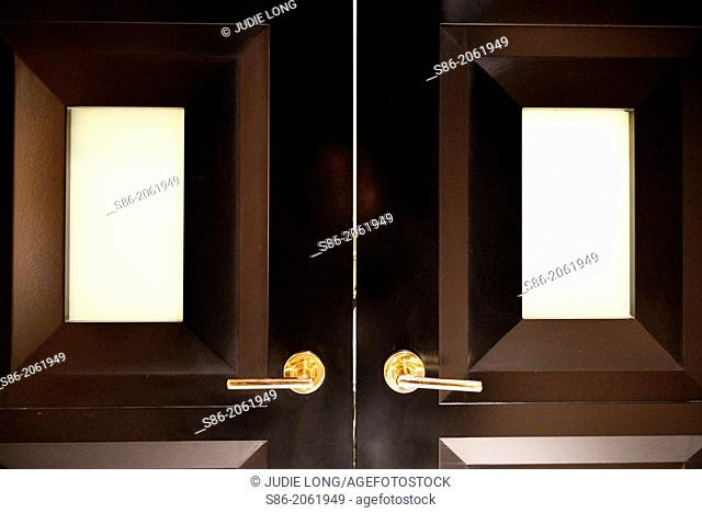 Closed Double Doors, Frosted Glass Panel Windows, Lights on Other Side, Las Vegas, NV, USA