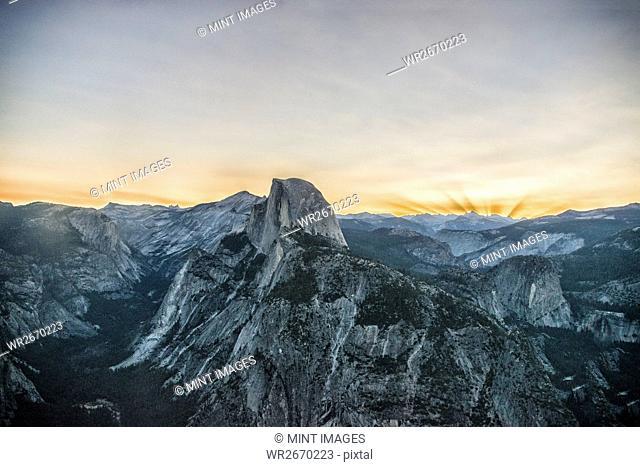The mountain range in Yosemite valley at sunset. The Half Dome landmark