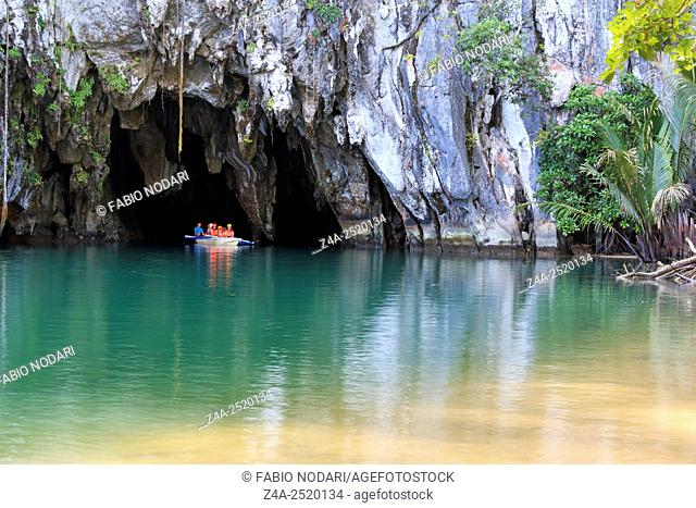 Puerto Princesa, The Philippines: Tourists on boat at the entrance of the Underground River, one of the new Seven Wonders of the nature