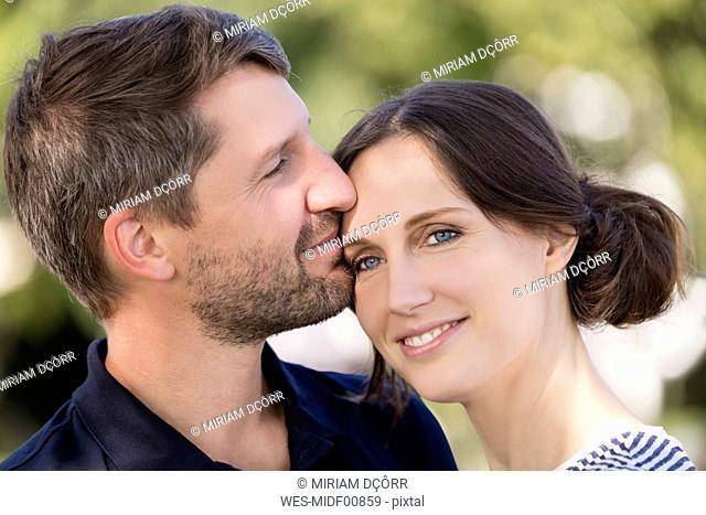 Portrait of happy couple outdoors