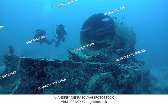 diver inspects locomotive crashed on board the wreck SS Thistlegorm, Red Sea, Sharm el Sheikh, Egypt, Sinai
