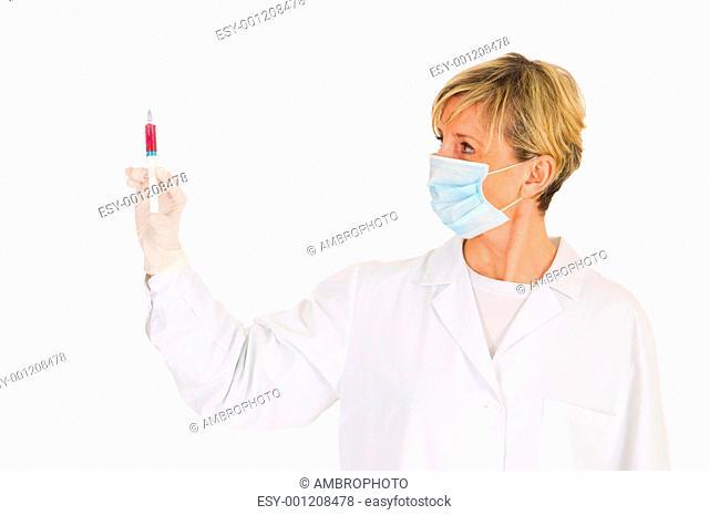 female doctor with mask holding a syringe