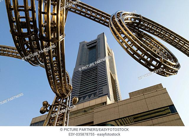Yokohama, Japan - June 15, 2017: Futuristic stainless steel construction and the Landmark tower on Queen's Square shopping centre in Minato Mirai, Yokohama