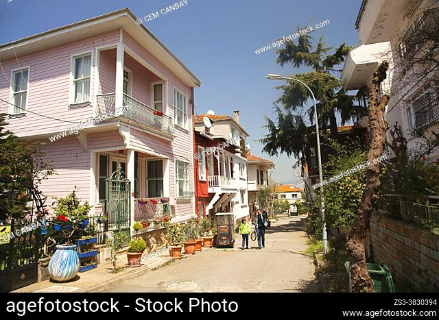 People walking in front of the traditional wooden houses in Büyükada, Buyukada-Prinkipos, the largest of the Princes' Islands, Marmara Sea, Istanbul Turkey