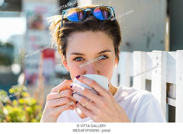 Portrait of woman drinking cup of coffee