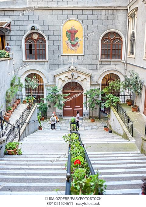 People visit Church of St. Mary Draperis, a Roman Catholic Church built in 1584 Beyoglu, Istanbul, Turkey. 25 July 2019