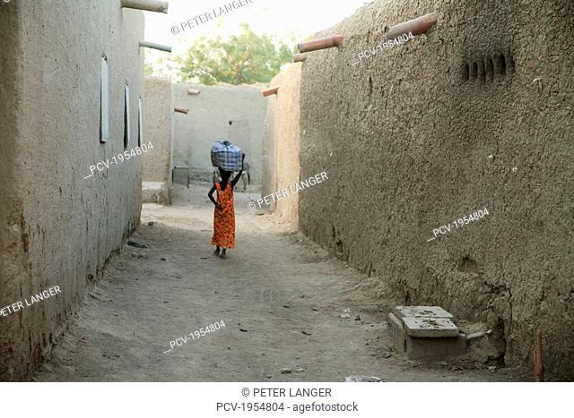 Rear view of a woman walking on street in Djenne, Mali