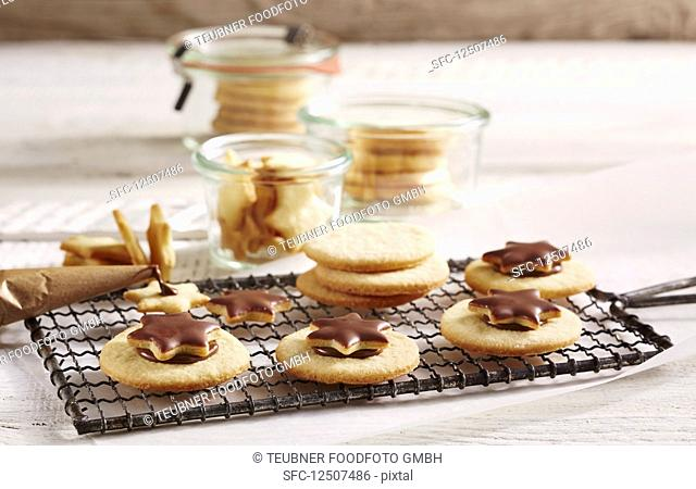 Chocolate spread sandwich biscuits topped with stars